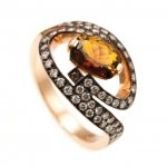 Anello in Oro Rosso, Diamanti taglio brillante e Tormalina<br /><em>Red Gold ring with round brilliant cut diamonds and Tourmaline</em>